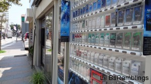 A cigarette vending machine next to a cigarette store