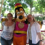 Me and my friend posing with the lifesize Goofy character.