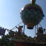 Mickey and his friends on a sailing boat with an air ballon attached