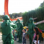 Green soldier characters drill children at the Hong Kong themepark.