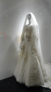 A white mannequin in a beaded wedding dress