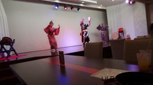Three dancers, one in eisa gear and two in traditional Japanese female outfits