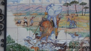 A tile mosaic of a knight on horseback lancing some sheep while labourers egg him on.